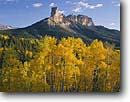 Stock photo. Caption: Aspens, Chimney Rock  & Courthouse Mountain, Owl Creek Pass Uncompahgre National Forest San Juan Mountains, Colorado -- fall peak peaks autumn rockies united states america landscape landscapes dramatic majestic mountain color colors forests tree trees deciduous spruce spruces arete sweeping view views vista scenic colour colours  sunny clear blue skies scenics scenic