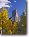 Stock photo. Caption: Aspens and Chimney Rock Uncompahgre National Forest San Juan Mountains Rocky Mountains, Colorado -- Owl Creek Pass fall peak peaks autumn rockies united states america landscape landscapes dramatic majestic mountain color colors forests tree trees deciduous spruce spruces arete  view views vista scenic colour colours landmark landmarks sunny blue skies