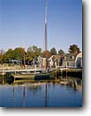 Stock photo. Caption: The Museum of America and the Sea Mystic Seaport New London County Connecticut -- tourist destination destinations attraction attractions historic historical sunny blue buildings building quaint villages village northern maritime living history  museums coastal american exhibits seaports fall autumn tall ships ship sailing sailboats