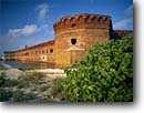 Stock photo. Caption: Garden Key Lighthouse Fort Jefferson Dry Tortugas National Park Gulf of Mexico,  Florida -- parks united states america protection beacon beacons navigational aids dive site history historical forts historic tropical tourist destination destinations diving sunny clear blue skies building buildings brick safe isolated strength strong trust tough