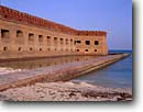 Stock photo. Caption: Fort Jefferson Dry Tortugas National Park Gulf of Mexico Florida -- parks moon moons america protection dive site history historical forts historic tropical tourist destination destinations diving sunny clear blue skies winter brick building buildings surrounded water isolated landscape landscapes safe tough protected