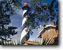 Stock photo. Caption: St. Augustine Lighthouse Anastasia Island St. Augustine Florida -- tourist destination destinations attraction attractions historic historical sunny blue buildings building lighthouses lighthouse lights maritime coastal american station tree tropical ocean coastline coastlines landscapes scenic skies safe tower striped