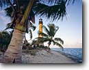 Stock photo. Caption: Coconut palms and Cape Florida Light Key Biscayne Miami-Dade County Florida -- tourist destination destinations attraction attractions historic historical sunny blue buildings building lighthouses light maritime coastal american station tree palm tropical beach beaches ocean coastline coastlines seashore seashores landscapes scenic
