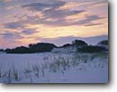 Stock photo. Caption: Sunrise over sand dunes Santa Rosa Island Gulf Islands National Seashore Florida -- united states america seascape seascapes sunsets beach islands clouds surf waves beaches seashores parks deep south southern southeast southeastern states travel tourist destination destinations shoreline shorelines dune