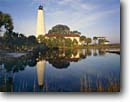 Stock photo. Caption: St. Marks Lighthouse St. Marks National Wildlife Refuge Gulf of Mexico Florida -- tourist destination destinations attraction attractions historic historical sunny blue buildings building lighthouses lights maritime coastal american station tropical ocean coastline coastlines landscapes scenic skies safe tower refuges reflections