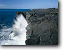 Stock photo. Caption: Holei Sea Arch Pacific Ocean Hawaii Volcanoes National Park Island of Hawaii, Hawaii -- tourist destination destinations attraction sites sunny blue coastal tropical ocean coastline coastlines landscapes scenic skies turquoise tropics tropical hawaiian vacation  warm warmth color crashing waves wave arches parks world heritage site islands