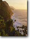 Stock photo. Caption: Kalalau Trail Na Pali Coast Island of Kauai Hawaii -- tropical hiking trails danger destination destinations parks beaches winter islands pacific ocean backpacking wilderness landscape landscapes sunset sunsets headland headlands coastline secluded wild solitude isolation motivation coastal rugged coastlines