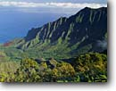 Stock photo. Caption: Kalalau Valley and Na Pali Coast   from Kalalau Lookout Kokee State Park Island of Kauai, Hawaii -- cliffs napali ocean pacific clouds tropical islands parks coasts lookouts destination destinations united states vacations vacation travel tourist attraction attractions hawaiian valleys vista vast time coastline coastlines distance landscape landscapes
