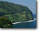 Stock photo. Caption: Honomanu Bay Hana Highway Island of Maui Hawaii -- hawaiian islands seascape sescapes   trees winter tropical destination destinations travel tourist vista vistas trees cliff cliffs united states america road roads secluded beaches beach shoreline paradise scenic shorelines sunny clear skies blue scenics