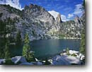 Stock photo. Caption: Wilson Lake, Fishfin Ridge  and Bighorn Crags Frank Church River of No Return Salmon National Forest Rocky Mountains,  Idaho -- Keywords: united states america peak peaks tranquil forests mountains calm majestic landscape landscapes mountain rocky rockies national ponds subalpine summer areas lakes wildernesses highcountry backcountry backpacking backpack wilderness wildernesses