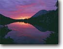 Stock photo. Caption: Sunrise over Toxaway Lake Sawtooth Mountains   and Wilderness Sawtooth Nat. Recreation Area Challis National Forest, Idaho -- Keywords: united states america reflection peak peaks tranquil forests reflections  calm majestic landscape landscapes mountain rocky rockies national ponds subalpine summer areas lakes sunset sunsets backcountry high country wildernesses