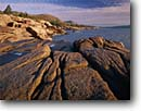 Stock photo. Caption: Newport Bay, Sand Beach and The Beehive Acadia National Park Mount Desert Island Maine,  New England -- polished rocks rocky parks atlantic coast ocean seascape seascapes england northeast northeastern united states america landscape landscapes travel tourist destination destination headlands coastline rugged coastlines islands sunny clouds seashore