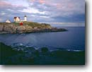 Stock photo. Caption: Cape Neddick Light (Nubble Light) Sohier Park York County Maine, New England -- seascape seascapes tourist destination destinations attraction attractions northern lighthouses station stations parks lighthouse rainbow rainbows coast coastal coastline coastlines landscape landscapes scenic scenics tower protection rock solid ocean