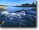 Stock photo. Caption: Tidewater rapid at low tide Reid State Beach Georgetown Island Sagadahoc County,  Maine New England -- Keywords: united states america waves rocky headlands summer new england blue water wave seadscape seascapes waterfall waterfalls rapids coastal islands coastline shoreline shorelines tidal basin basins intertidal reversing