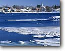 Stock photo. Caption: Harbor in winter Damariscotta Maine -- united states america winter snowy snow east eastern northeastern northeast new England coast atlantic coastline landscape landscapes coastal shoreline shore shores cold building buildings village harbour harbors harbours boats boat