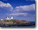 Stock photo. Caption: Cape Neddick Light Sohier Park York County Maine,  New England -- united states seascape seascapes coast coastline atlantic new england northeast lighthouse lighthouses blue skies daytime atlantic ocean northeastern protection beacon beacons direction guidance pharos navigation america navigational red roof headland