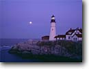 Stock photo. Caption: Portland Head Light Fort Williams Casco Bay Maine,  New England -- united states seascape seascapes coast coastline atlantic northeast lighthouse lighthouses blue skies atlantic ocean northeastern protection beacon beacons direction guidance pharos navigation america navigational red roof headland moon moons lizzy