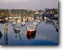 Stock photo. Caption: Perkins Cove Harbor at sunrise Ogunquit Maine New England -- seascape seascapes tourist destination destinations attraction attractions northern coast coastal coastline coastlines landscape landscapes scenic scenics harbors harbours harbour boats boat fishing leisure sailboats sailboat protected moored buildings