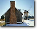 Stock photo. Caption: Spocott Windmill Cambridge Dorchester County Maryland -- landscape landscapes scenics scenic united snow america windmills attraction attractions tourist american alternative green energy power wind historical historic building buildings blades blade working winter sunny blue skies classic landmark landmarks