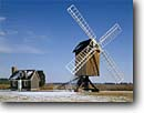 Stock photo. Caption: Spocott Windmill Cambridge Dorchester County Maryland -- landscape landscapes scenics scenic united america windmills attraction attractions tourist american alternative green energy power wind historical historic building buildings blades blade working sunny blue skies classic landmark landmarks winter snow