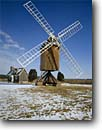 Stock photo. Caption: Spocott Windmill Cambridge Dorchester County Maryland -- landscape landscapes scenics scenic united america windmills attraction attractions tourist american alternative green energy power wind historical historic building buildings blades blade working sunny blue skies classic landmark landmarks snow