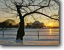 Stock photo. Caption: The Tidal Basin   and Jefferson Memorial at sunset Washington D. C USA -- americana nostalgic nostalgia united states america historic historical building buildings capitols cityscape cityscapes government power politics memorial memorials monuments district columbia snowfall snow winter cold wetlands wetland
