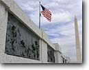 Stock photo. Caption: Bas-relief at World War II Memorial   with Washington Monument in distance Washington,  DC USA -- americana nostalgic nostalgia united states america historic historical building buildings statues capitols cityscape cityscapes government power politics memorial memorials district columbia pride memory nation nations proud american flag flying flags