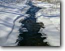 Stock photo. Caption: Chesapeake and Ohio Canal   National Historical Park Potomac River Maryland -- americana nostalgic nostalgia united states america historic snowfall winter snow cold landscape landscapes parks canals waterways  boat travel frozen freezing waterway artistic nature rivers