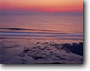 Stock photo. Caption: Sunrise over the Atlantic Ocean   from LeCount Hollow Beach Cape Cod National Seashore Massachusetts, New England -- united states northern northeastern seascapes seascape sun reflection atlantic ocean oceans beach orange reflections seashores sunsets coast coastal travel tourist destination destinations  sandy beaches