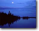 Stock photo. Caption: Moonrise from Merrits Lake Campsite   northeast of Rock Harbor Isle Royale National Park Lake Superior,  Michigan -- calm tranquil great lakes parks moonrises spiritual peaceful peace majestic symetry balance balanced moon rising reflection reflections  lake blue kayaking area areas canoeing evening light northern