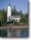 Stock photo. Caption: Rock Harbor Light Lake Superior Isle Royale National Park Michigan -- lights station stations lighthouse lighthouses lakes parks great lakes region united states america beacon beacons direction guidance navigation navigational aid aids midwestern midwest solid secure parks white landscape landscapes sunny clear summer