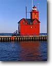 Stock photo. Caption: Holland Light (Big Red)   from Holland State Park Lake Michigan Lower Peninsula,  Michigan -- lighthouse light historic lighthouses great lakes protection beacon beacons direction guidance pharos navigation america navigational aids spring sunny blue skies time eternal solitude hope strength trust americana strong motivation power scenics scenic