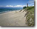 Stock photo. Caption: Little Sable Lighthouse Oceana County Lake Michigan Michigan -- attraction attractions northern lighthouses stations coast coastal landscape landscapes scenic scenics protection buildings building great lakes tower summer light station beach beaches shoreline shorelines sandy destinations sand destination