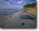 Stock photo. Caption: Sandstone near Mosquito River Pictured Rocks National Lakeshore Lake Superior Upper Peninsula Michigan -- shore shoreline ripples ripple rocky beach beaches lakeshores summer great lakes united states america ancient lakebed lakebeds petrified landscape landscapes travel tourist destination destinations rippled ripple rock
