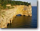 Stock photo. Caption: Grand Portal Point Pictured Rocks National Lakeshore Lake Superior Upper Peninsula,  Michigan -- shore shoreline great lakes united states america landscape landscapes travel tourist destination destinations kayaking canoeing area arch arches sunny clear lakeshores cliffs hole canoe through kayak