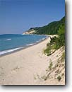 Stock photo. Caption: Empire Bluffs and Lake Michigan  from Platte Bay Sleeping Bear Dunes National Lakeshore Lower Peninsula, Michigan -- attraction attractions northern landscape landscapes scenic scenics great lakes summer destinations sunny clear blue skies shore sandy beach beaches sand lakeshores dune destinations tourist family