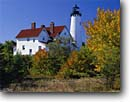 Stock photo. Caption: Point Iraquois Light Lake Superior Hiawatha National Forest Upper Peninsula, Michigan -- lights station stations lighthouse lighhouses maple maples fall autumn tree trees northern midwest midwestern protection beacon beacons direction guidance navigation america navigational aids sunny blue skies clear foliage houses house buildings scenics