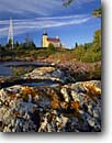 Stock photo. Caption: Copper Harbor Light Fort Wilkens State Park Keweenau Peninsula Michigan -- ighthouse lighthouses lakes station stations states united america upper rocky shore evening light fall autumn great protection beacon beacons direction guidance pharos navigation navigational aids rugged coastline safe sunny rugged shoreline tower