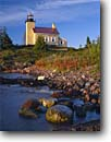 Stock photo. Caption: Copper Harbor Light,  Lake Superior Fort Wilkens State Park Keweenau Peninsula Keweenau County,  Michigan -- serene calm trust reliable lighthouse lighthouses lakes station stations  upper rocky shore evening light fall autumn great protection beacon beacons direction guidance pharos navigation navigational aids rugged coastline safe sunny rugged shoreline tower