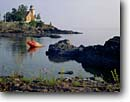Stock photo. Caption: Eagle Harbor Light Lake Superior Eagle Harbor, Keweenau County Keweenau Peninsula, Michigan -- attraction attractions northern lighthouses stations landscape landscapes scenic scenics protection buildings building great lakes summer lights station house houses destinations tower sunny clear blue skies lighthouse stations calm safe safety