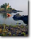 Stock photo. Caption: Eagle Harbor Light Lake Superior Eagle Harbor, Keweenau County Keweenau Peninsula, Michigan -- attraction attractions northern lighthouses stations landscape landscapes scenic scenics protection buildings building great lakes summer lights station house houses destinations tower sunny clear blue skies lighthouse stations calm safe safety shores