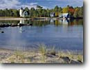 Stock photo. Caption: Bette Grise Light, Lac La Belle Bette Grise Bay, Lake Superior Keweenau Peninsula Keweenau County, Michigan -- attraction attractions northern lighthouses stations landscape landscapes scenic scenics protection buildings building great lakes lights station house houses destinations tower sunny clear blue skies lighthouse stations calm safe safety fall autumn sandy