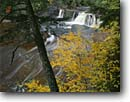 Stock photo. Caption: Manabezho Falls Presque Isle River Porcupine Mountains Wilderness State Park, Upper Peninsula, Michigan -- attraction attractions northern landscape landscapes scenic scenics great lakes destinations rivers water flowing destination creek creeks waterfall waterfalls parks large trees wilderness mountain autumn fall