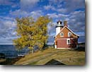Stock photo. Caption: Eagle Harbor Light Lake Superior Eagle Harbor, Keweenau County Keweenau Peninsula, Michigan -- attraction attractions northern lighthouses stations landscape landscapes scenic scenics protection buildings building great lakes fall autumn lights station house houses destinations sunny clear blue skies lighthouse stations calm safe safety