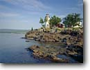 Stock photo. Caption: Eagle Harbor Light Lake Superior Eagle Harbor, Keweenau County Keweenau Peninsula, Michigan -- attraction attractions northern lighthouses stations landscape landscapes scenic scenics protection buildings building great lakes summer lights station house houses destinations sunny clear blue skies lighthouse stations calm safe safety