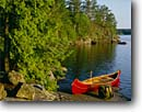 Stock photo. Caption: Canoe, Little Saganaga Lake Boundary Waters Canoe Area Superior National Forest Minnesota -- wilderness wildernesses lakes outdoor adventure recreation canoeing canoes morning camping paddling lakes forests areas landscape landscapes travel water sports sport destination destinations solitude shoreline shorelines boat boats scenic scenics