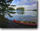 Stock photo. Caption: Canoe, Crab Lake Boundary Waters   Canoe Area Superior National Forest North Woods, Minnesota -- red canoes canoeing wilderness wildernesses areas forests outdoor recreation experience experiences united states america summer landscape landscapes travel destination destinations camping secure serence scene scenic boating boat boats family vacation