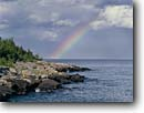 Stock photo. Caption: Clearing storm,  Magnet Island Grand Portage Indian Reservation Lake Superior Cook County,  Minnesota -- rainbow united states america rainbow clouds great lakes region clearing storm storms rainbows reservations landscape landscapes lakeshore lakeshores stormy storm weather phenomenon