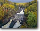 Stock photo. Caption: Beaver River North Shore Lake Superior Lake County Minnesota -- northern tree trees upper midwest united states america forest forests aspens maples rivers waterfall waterfalls autumn fall great lakes foliage midwestern water running habitat power powerful rivers