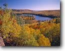 Stock photo. Caption: Tettegouche Lake   and Lake Superior Tettegouche State Park Lake County,  Minnesota -- northern upper midwest united states america great lakes midwestern water habitat parks blue skies beaches  scenics scenic views clear clean fall autumn foliage  sunny landscape landscapes